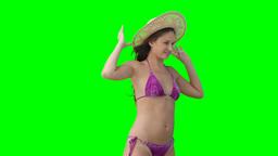 A woman in a bikini eith her hat falling off Footage