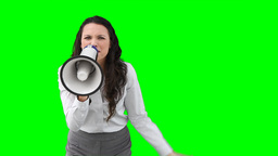 A business woman roaring through a megaphone Footage