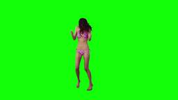 Woman wearing a bikini is dancing Stock Video Footage