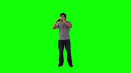 A man looking through binoculars is turning Footage
