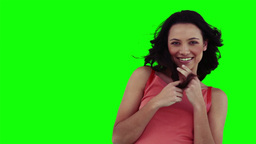 A smiling woman is playing with her hair Footage