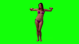 A woman wearing a bikini is lifting weights Stock Video Footage