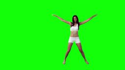 A woman is doing star jumps Stock Video Footage