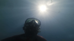 Underwater sunrays and diver Footage