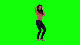 A smiling woman is dancing on her own Footage