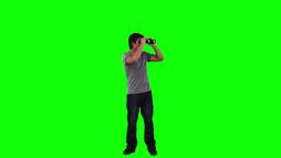A man looking around through binoculars Stock Video Footage