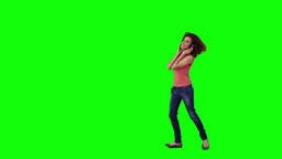A woman jumping around is wearing headphones Stock Video Footage