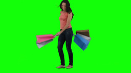 An excited woman is holding shopping bags Footage