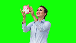 Smiling woman in slow motion throwing a piggy bank Stock Video Footage