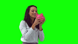 Happy woman in slow motion holding a piggy bank Stock Video Footage