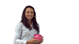 Smiling brunette in slow motion holding a piggy ba Footage