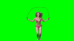 Woman skipping over a rope Footage