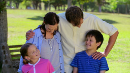 Smiling family standing upright together Footage