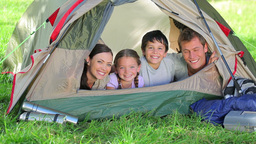 Family smiling while lying in a tent Footage