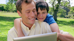 Father and son looking at an ebook Footage
