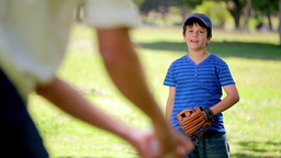 Smiling boy playing baseball while standing uprigh Footage