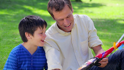 Father and son holding a kite Stock Video Footage