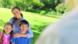 Smiling mother posing with her children Stock Video Footage