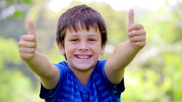 Smiling child placing his thumbs up Footage