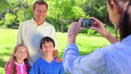 Smiling father standing with his children Footage
