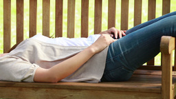 Woman lying on a bench Stock Video Footage
