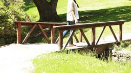 Woman walking on a bridge Stock Video Footage