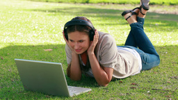 Woman listening to music with a laptop in front of Stock Video Footage