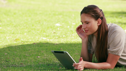 Woman using an eBook reader Footage