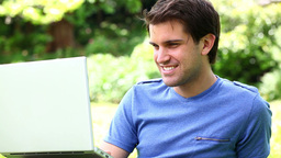 Happy man using a laptop Stock Video Footage