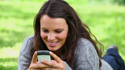 Smiling brunette woman sending a text message Footage