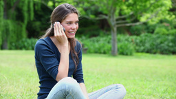 Smiling young woman using a mobile phone Footage