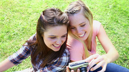 Smiling friends photographing themselves Footage