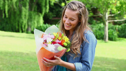 Joyful woman receiving a bunch of flowers Stock Video Footage