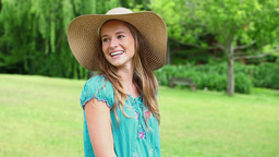Happy woman holding her straw hat Footage