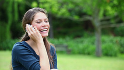 Happy woman chatting on the phone Stock Video Footage