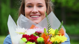 Smiling woman holding flowers Footage