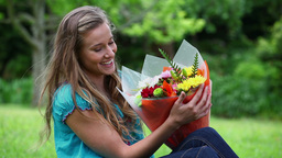 Cheerful woman holding a bunch of flowers Footage