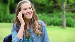 Happy young woman talking on the phone Footage