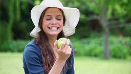 Smiling woman eating an apple Stock Video Footage