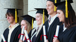 Happy students holding their tassels Footage