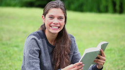 Happy brunette woman reading a book Footage