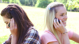 Smiling friends using their cellphones Stock Video Footage