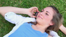 Smiling woman talking on her cellphone Stock Video Footage