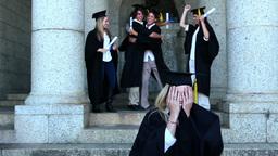 Graduates celebrating their graduation Footage