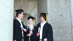 Graduates giving highfive Stock Video Footage