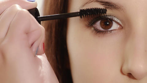 Girl Applying Mascara stock footage