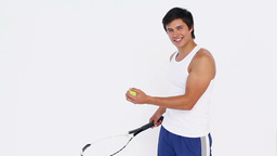 Tennis player bouncing ball on racket Footage