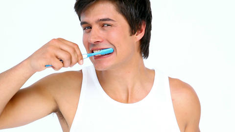Man brushing and looking his teeth Footage