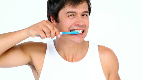 Man brushing and looking his teeth Stock Video Footage