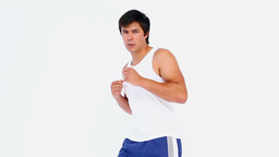 Man in sportswear kick boxing Stock Video Footage
